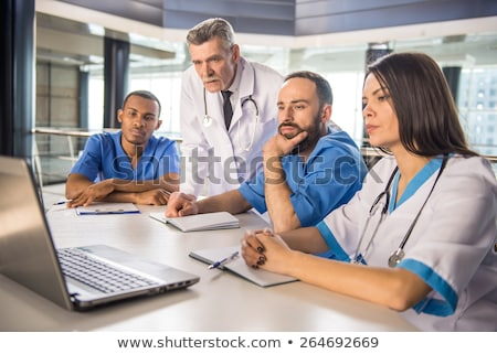 Health care professionals working in laboratory. Stock photo © kasto