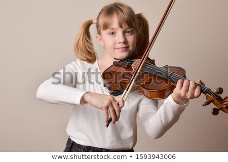 young girl at school learning to play violin stock photo © highwaystarz