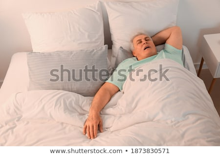 mature man with sleeping problems stock photo © tab62