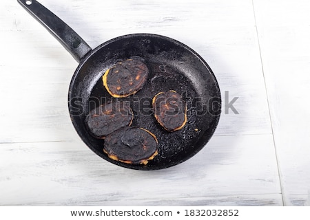 old rusty frying pan stock photo © dezign56