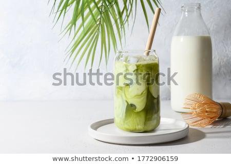 Glass of iced green tea latte Stock photo © nalinratphi
