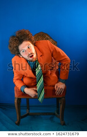 Full length portrait of a young man trying to hear something Stock photo © deandrobot