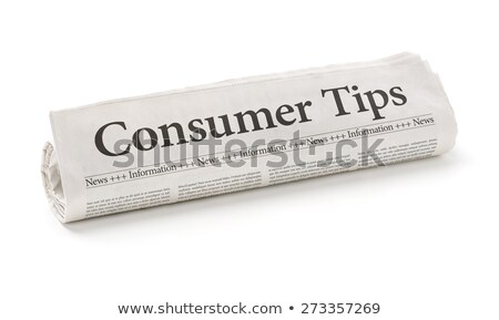 rolled newspaper with the headline consumer tips stock photo © zerbor