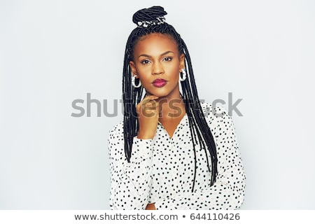 Stock photo: Serious young woman with trendy coiffure