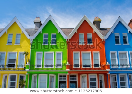 Street houses in blue and red color Stock photo © Sportactive