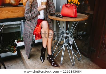 Happy woman in red dress holding handbag stock photo © deandrobot
