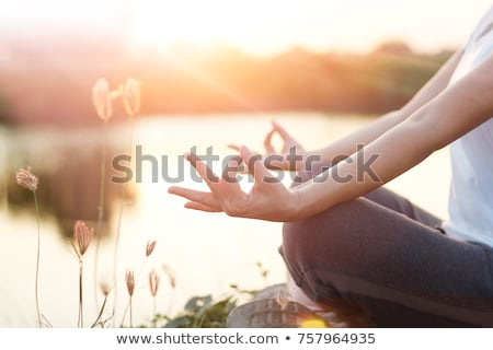 Silhouette practicing yoga in abstract background Stock photo © ankarb