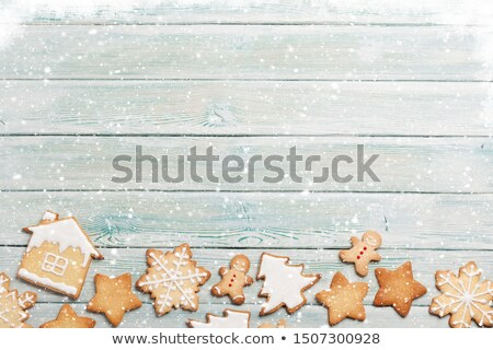 Foto stock: A Gingerbread Man On A Wooden Background With Christmas Decorati
