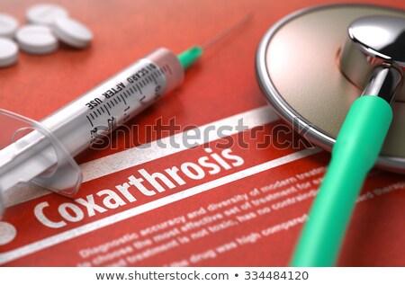 Coxarthrosis - Printed Diagnosis on Orange Background. Stock photo © tashatuvango