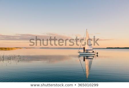 Hajók derűs naplemente csendes vad út Stock fotó © morrbyte