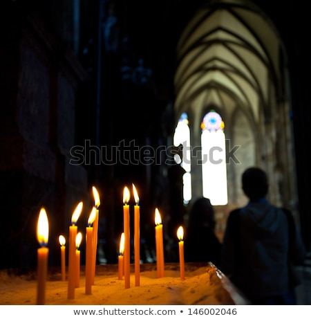 candles in the catholic church shallow depth of field stock photo © alex_grichenko