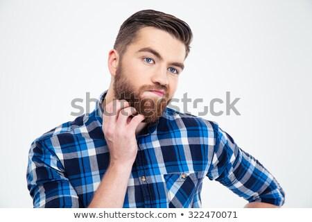 Homem bonito em pé tocante barba branco Foto stock © deandrobot