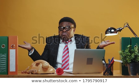 Portrait of a man shrugging shoulders Stock photo © deandrobot