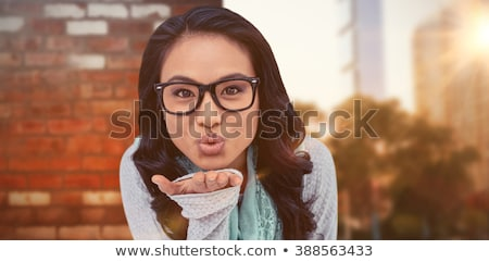 Stockfoto: Composite Image Of Asian Woman Blowing Kiss To The Camera