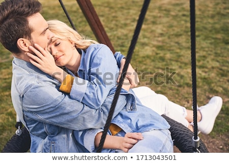 serious handsome man with his blond lovely wife stock photo © konradbak