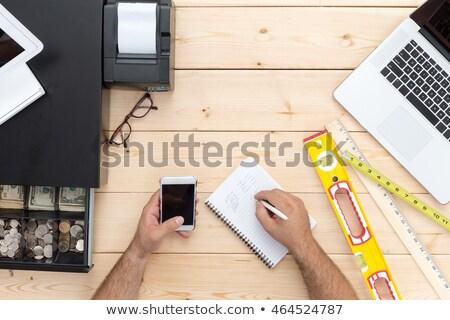 empresário · escrita · notas · telefone · móvel · mesa · de · escritório · trabalhando - foto stock © ozgur