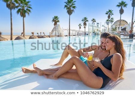 Nő függőágy trópusi üdülőhely medence színes Stock fotó © dash