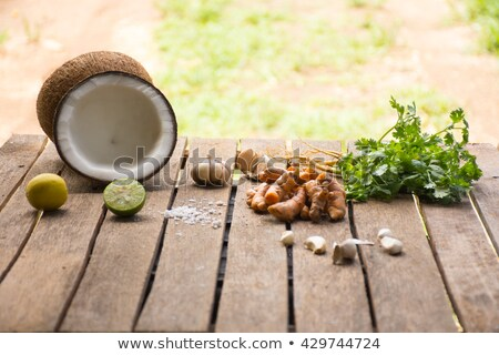 Raw material for food and dessert.Lemon and coconut  coriander and turmeric on old wooden background Stock photo © Bigbubblebee99