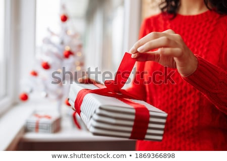 The young woman excited with giftbox Stock photo © Elnur