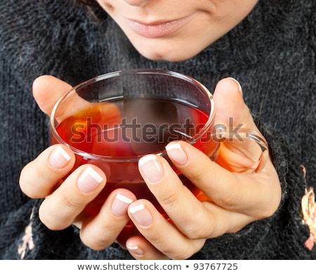 Mosolyog vonzó lány pulóver tart teáscsésze közelkép Stock fotó © deandrobot