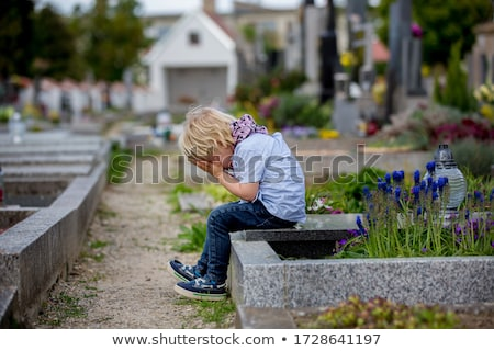 Boy crying in tears at gravestone Stock photo © bluering
