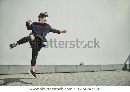 若い男 着用 バーチャル 現実 ジャンプ ストックフォト © deandrobot