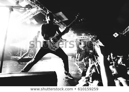Stock fotó: Játszik · nehézfém · színpad · fotó · fiatalember · elektromos · gitár