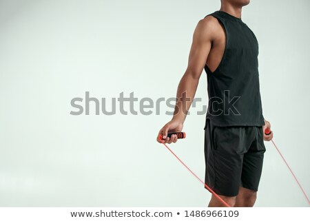 Cropped photo of handsome young african sportsman posing Stock photo © deandrobot