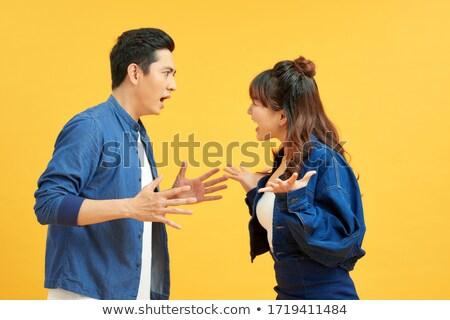 Portrait of a young, fighting couple Stock photo © konradbak