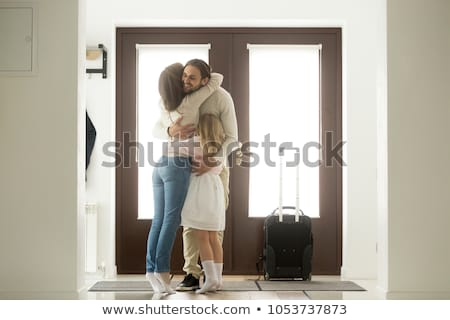 man and woman hugging in the doorway Stock photo © tekso