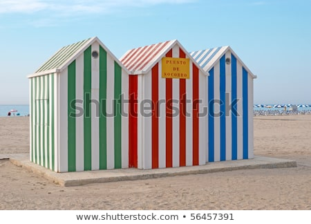 Multi colored wooden beach huts on sand Stock photo © wavebreak_media