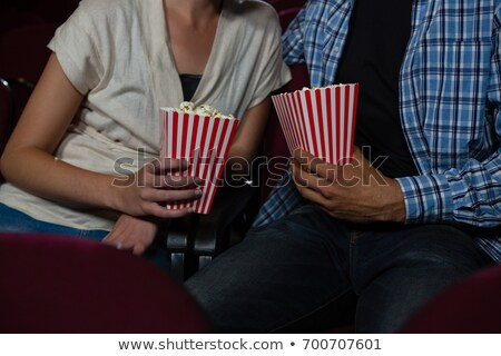 Mid-section of couple watching movie in theatre Stock photo © wavebreak_media