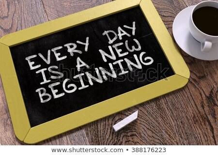 Kézzel rajzolt nap új kezdet tábla kicsi Stock fotó © tashatuvango