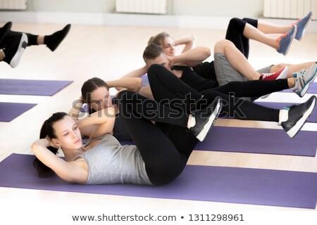 concentrado · fuerte · gimnasio · mentiras · piso - foto stock © deandrobot