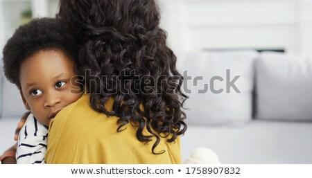 Kicsi gyermek rejtőzködik anyák ölel otthon Stock fotó © deandrobot