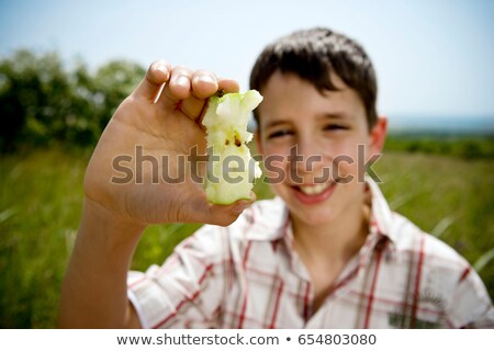 Boy holding up apple core Stock photo © IS2