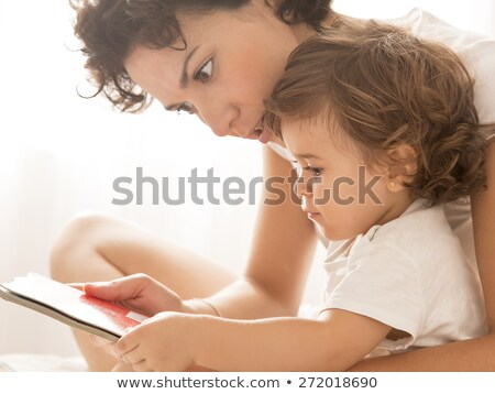 Mother and her baby reading book Stock photo © IS2