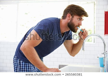 Man about to brush teeth Stock photo © IS2