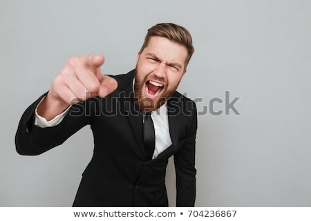 angry man pointing finger to you over gray stock photo © dolgachov