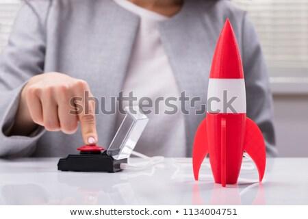 Hand Finger Press Achieving Career Goals Button. Stock photo © tashatuvango