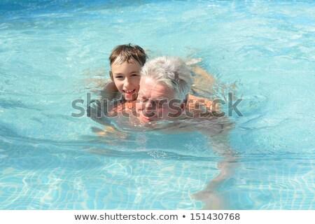 grand-père · petit-fils · plage · famille · coucher · du · soleil · mer - photo stock © is2