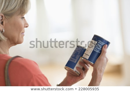 Woman comparing products Stock photo © IS2