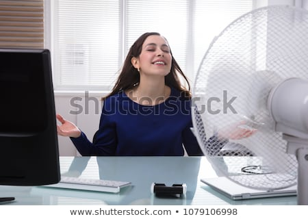 女性実業家 冷却 電気 ファン 笑みを浮かべて 小さな ストックフォト © AndreyPopov