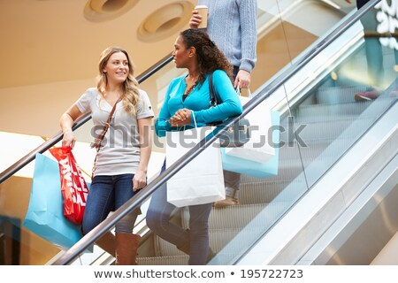 Deux femmes escalator femme Shopping Homme souriant Photo stock © IS2