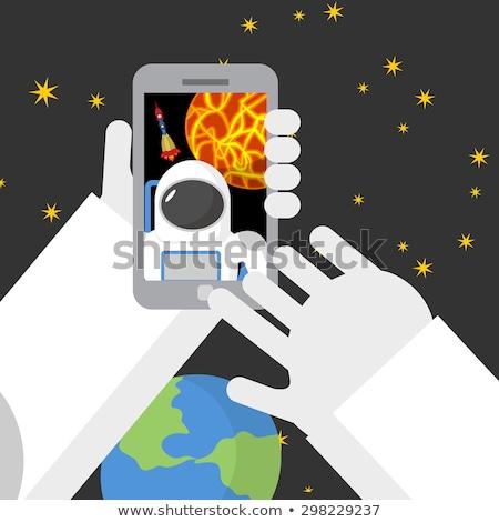 пространстве астронавт телефон фон ракета стороны Сток-фото © popaukropa