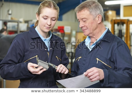 two machinists working on machine stock photo © monkey_business