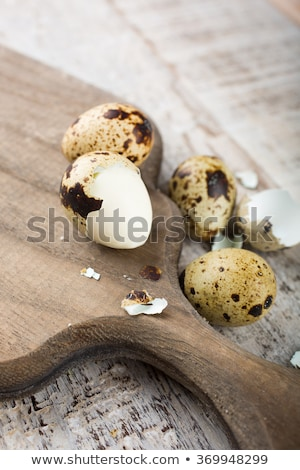 Quail eggs, green branches and vintage wooden cutting board Stock photo © Melnyk