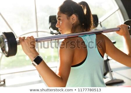 Ver de volta esportes mulher exercer barbell Foto stock © deandrobot