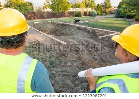 Male and Female Workers Overlooking Pool Construction Site Stock photo © feverpitch