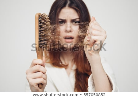Woman Holding Comb With Hair Loss Stock photo © AndreyPopov
